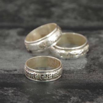 Spinning Silver Om Ring