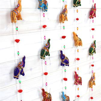 String of Elephants with Bell